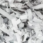 A close up of shredded paper after being properly disposed.